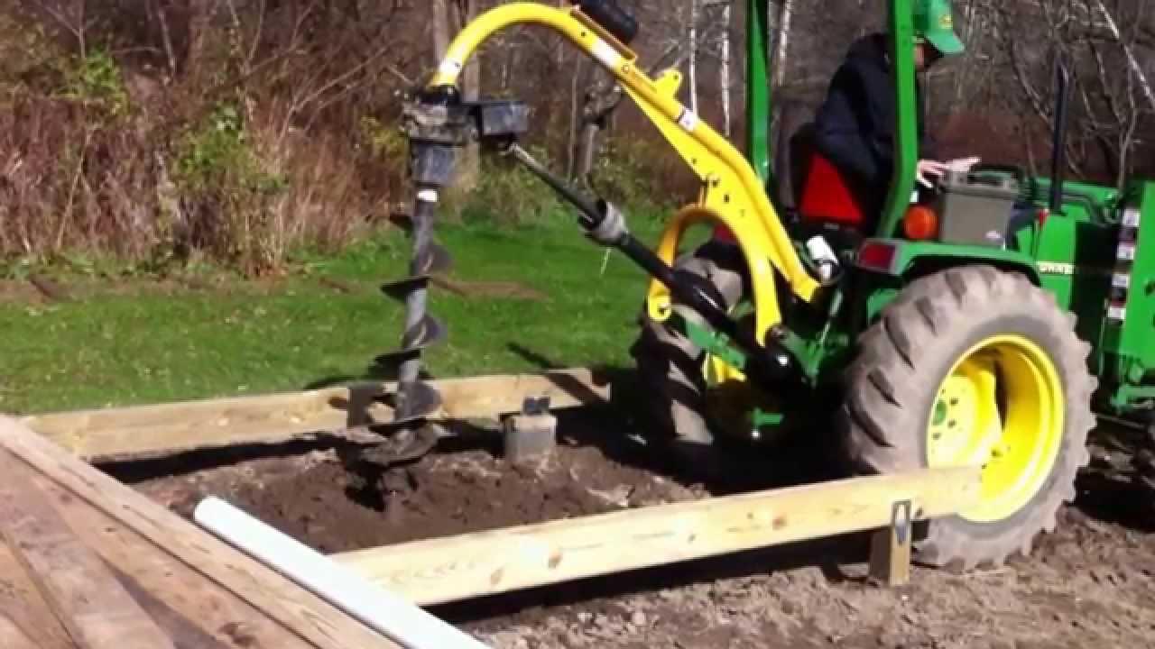 John Deere 790 Post hole digger