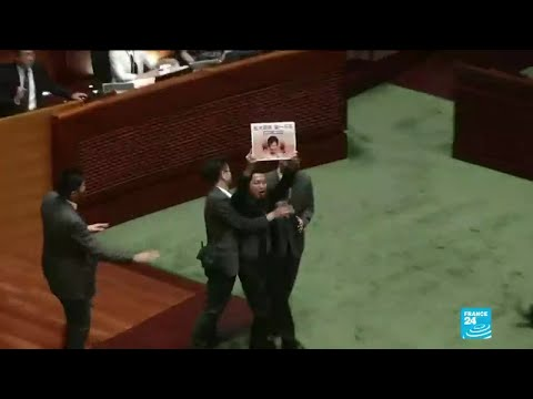 hong-kong-lawmakers-dragged-from-chamber-as-carrie-lam-is-heckled-onceagain
