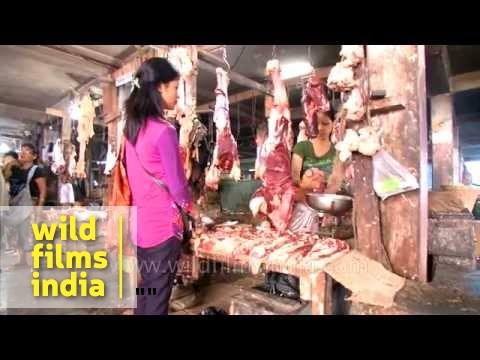 Women shop for prime cuts at meat market in Mizoram