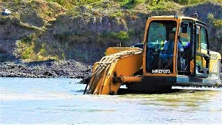 Excavator Deep Digging Sand From The River Hyundai R220-9S Doosan DX225LCA