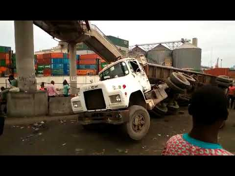 The gridlock in Apapa was compounded as truck conveying a container tipped over at TinCan Port