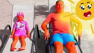 Milusik and papa playing with a cheerful sun