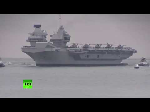 Thousands welcome Britain's biggest warship arriving at Portsmouth