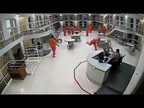 Tulsa County Jail - Wild Inmate Throws Chair Then Throws Out His Back