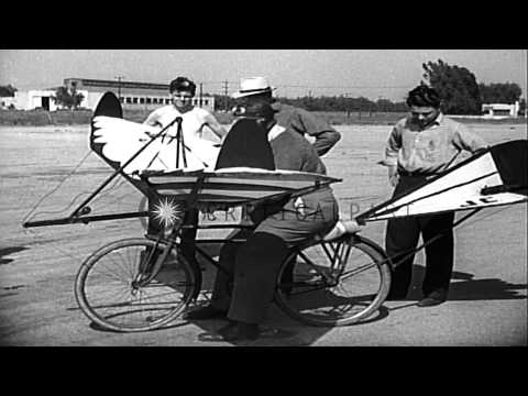 A butcher demonstrates his rocket propelled bicycle at Metropolitan Airport in Va...HD Stock Footage