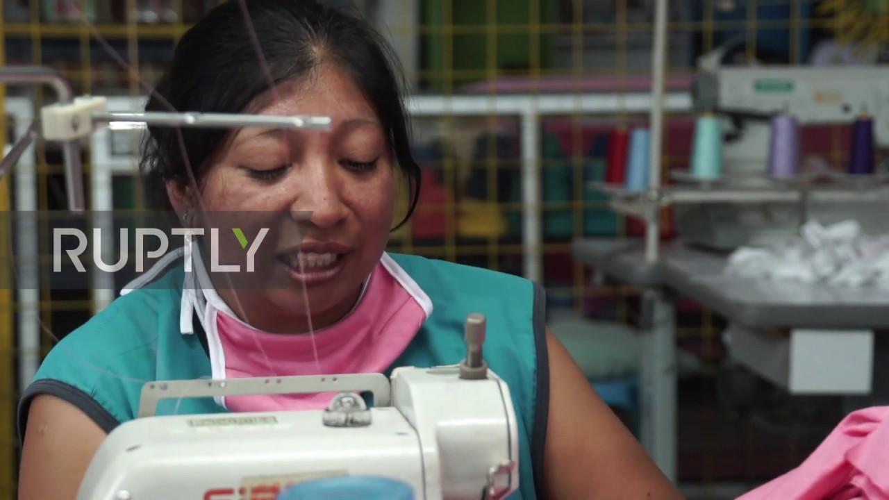 Ecuador: Seamstresses make cotton face masks to fight coronavirus outbreak