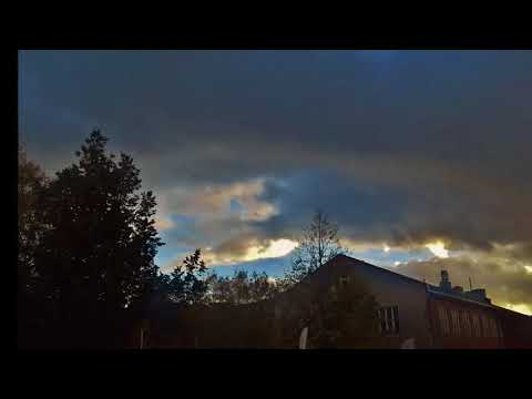 Interdimensional clouds coverin world snake like object ships or entity