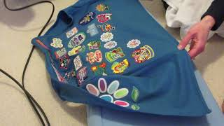 Ironing on Girl Scout Badges