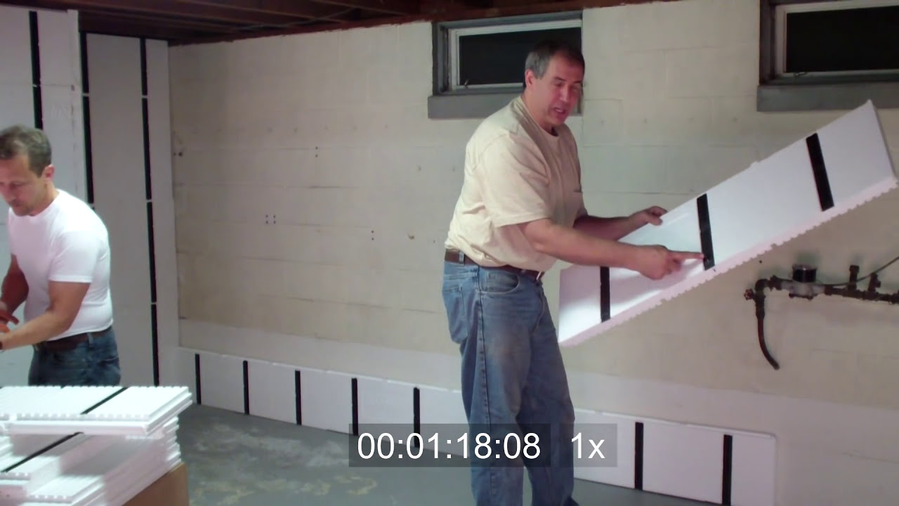 Frame and insulate a basement wall in under 10 minutes doovi for Basement wall insulation blanket