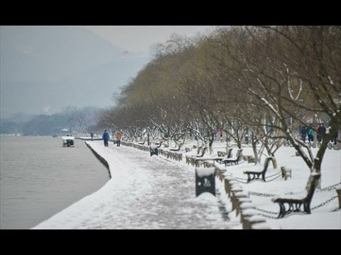 first snow visits Hangzhou Zhejiang China painting West Lake in Beauty