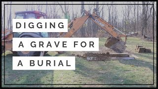 Digging a grave for a burial at a cemetery