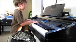 Lucas plays Down to Earth from Wall-e on piano