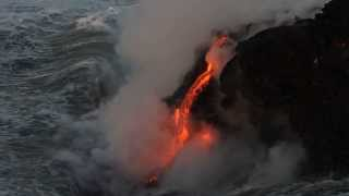 Beautiful lava flowing into the sea at night, The Big Island, Hawaii