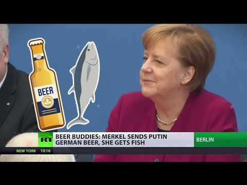 Putin gets beer from Merkel, sends smoked fish back