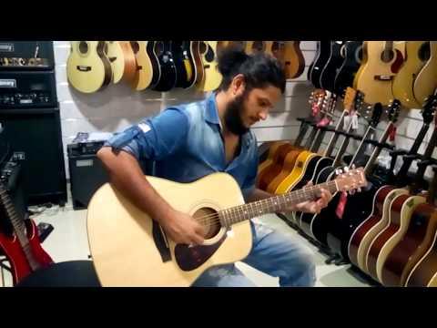 Guitar Playing at Furtados Music by Diwakar Singh Kachhawaha