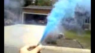Holding a smoke bomb