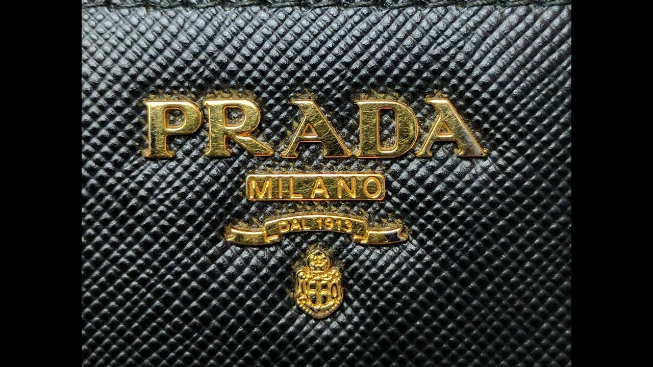 51e150e68fc9 Prada Bi-Fold Tab Wallet (wear and tear after 2 years of use) REQUESTED