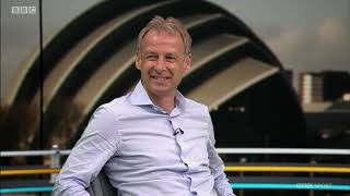 Gary Lineker asks Jürgen Klinṡmann if he would consider the vacant manager's position at Tottenham