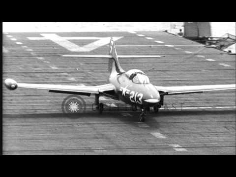 US Grumman F9F Panther Jet aircraft flies over water and lands on the deck of USS...HD Stock Footage