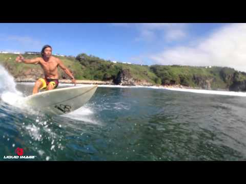 Surfing with the Liquid Image Ego in Honolua Bay, Maui.