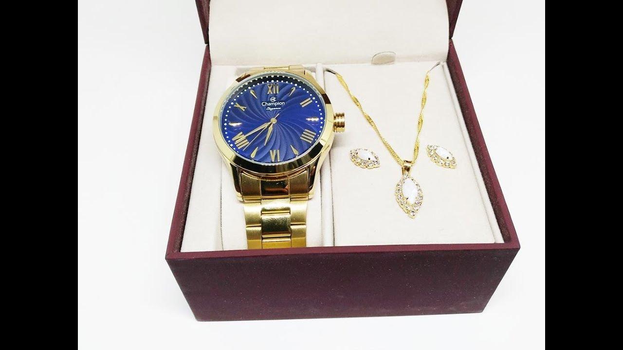 d7a204b8b38 Kit Relógio Champion Feminino Dourado Azul CN27796K Brinde Colar e Brincos