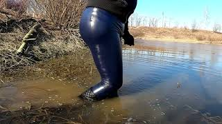WetLook 216 Girl in leather leggings and rubber boots in the water