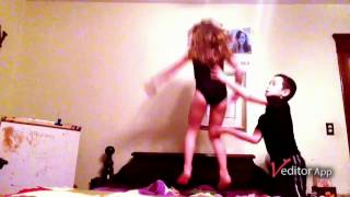 Little girl falls off bed onto her head