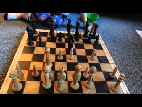 4 year old Noah chess game setup