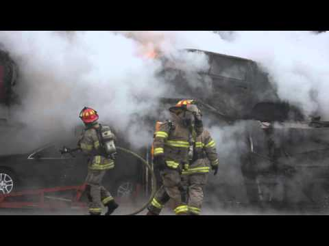 Car hauler engulfed in flames on US 23