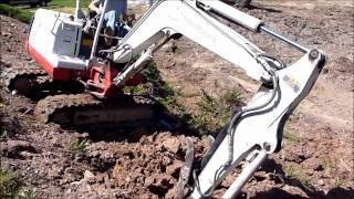 Mini Excavator Working a Steep Slope