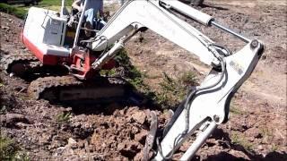 Mini Excavator Working a Steep Slope