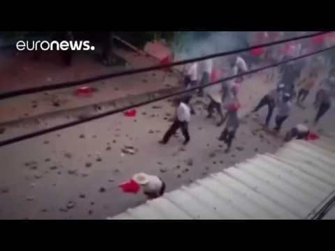 Locals pelt riot police in China democracy village