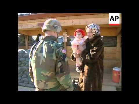 KOSOVO: NATO PEACEKEEPERS SEARCH FOR WEAPONS