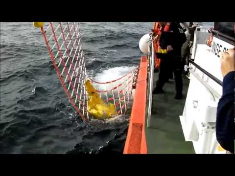 Small Dacon Rescue Scoop on SAR vessel