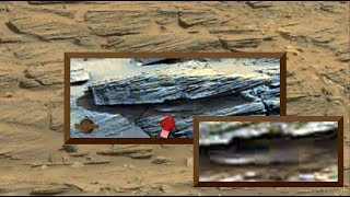 Reflective Metallic Craft Parked Under Obelisk like Stone on Mars