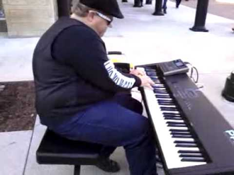Big Clayton Watson playing bluegrass on the piano