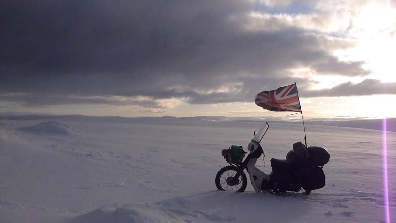 riding a honda c90 motorcycle through the arctic circle in winter