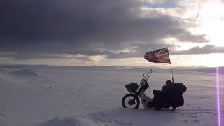 Riding a Honda C90 motorcycle through the Arctic Circle in Winter by Ed March