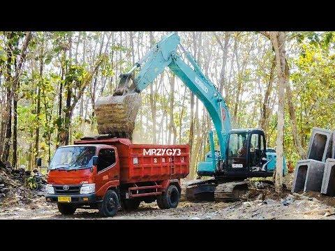 Kobelco SK200 Excavator And Bulldozer Working On Drainage Construction