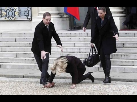 Danish PM Falls Down The Steps Of The Elysee Palace During Paris Rally