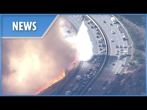 California Wildfires: choppers protect fleeing motorists