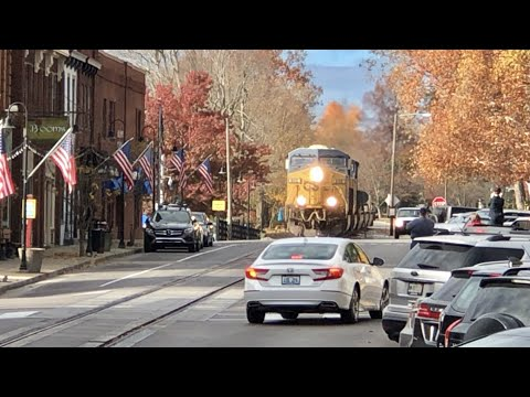 Driver Afraid To Turn In Front Of Street Running Train!  Train Running Down Middle Of Main Street