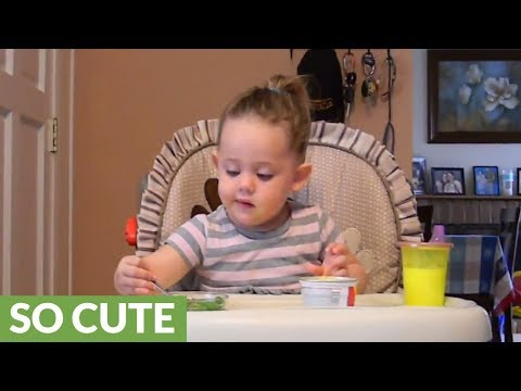 Toddler adorably 'curses' at slippery food