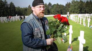 Placing flags on Gravestones of Veterans by Rough Riders MC