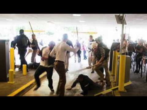Charlottesville: A gun in his face, but he got the photos By Greg Palast