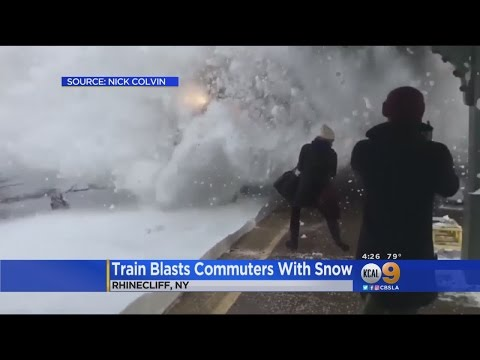 Onlookers Blasted With Snow As Train Barrels Into Station