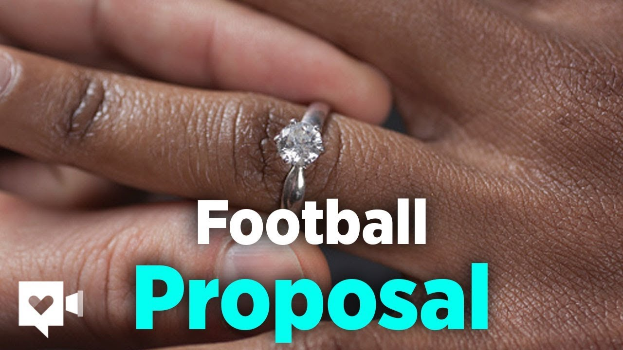 Football coach proposes with help of his players