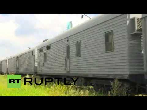 Ukraine: Bodies of MH17 victims arrive at Kharkiv train station