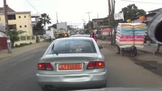 Scenes de rue a Douala Cameroon: Near miss with Motorcycle BEN SIKIN
