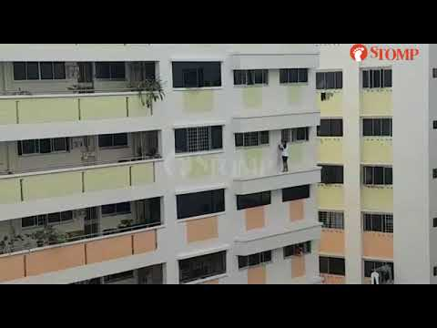24-year-old woman dangles from railing at Bukit Panjang block as resident grabs onto her